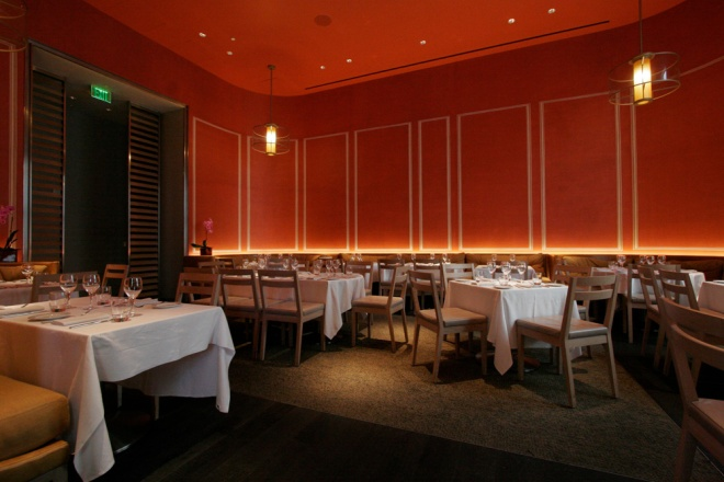 Warm White Linear lighting at DB Bistro by ECOSENSE made the wall color glow even warmer in this application.